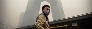 Heavy smog darkens the skies over Beijing in November 2014.
