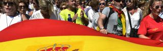Supporters of Spain's ruling Popular Party march behind a Spanish flag in Madrid on May 30, 2015 during a demonstration following the party's loss of votes in the recent regional and municipal elections.