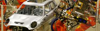 BMW mini cars pass through a robotic assembly line at a plant in Oxford on Jan. 17.