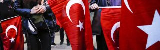 Turkish protesters wave flags outside the embassy in Rotterdam.