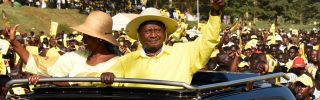 Ugandan President Yoweri Museveni, riding with his wife to a campaign rally Feb. 16, has used his government's control over the nation's resources to remain in power for decades.