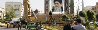 Medium-range ballistic missiles stand next to a portrait of Iranian Supreme Leader Ayatollah Ali Khamenei in Tehran on Sept. 25, 2017, during commemorations marking the anniversary of the 1980s Iran-Iraq war.