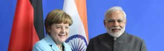 German Chancellor Angela Merkel (L) and Indian Prime Minister Narendra Modi shake hands after a conference in Berlin.