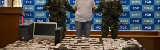 An alleged member of the Zetas drug cartel and money seized during his arrest