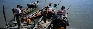 This photo taken on Oct. 2, 2019, shows fishermen boarding their boats at a small jetty on Made Island off Kyaukphyu in Myanmar'sRakhine state.