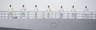 Sailors stand on the deck of the new type 055 guided missile destroyer Nanchang, belonging to the Chinese People's Liberation Army (PLA) Navy. China staged a naval parade on April 23 to commemorate the 70th anniversary of the founding of China's PLA Navy.