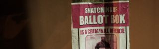 A warning poster is shown in Lagos, Nigeria, ahead of presidential and legislative elections on Feb. 16.