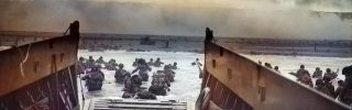 """A digitally colorized image of a photograph by Robert F. Sargent titled """"Into the Jaws of Death."""" Sargent captured troops from the United States Army First Infantry Division disembarking from an LCVP (landing craft) onto Omaha Beach during the Normandy Landings on D-Day during World War II, June 6, 1944."""