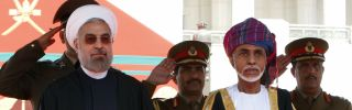 Omani leader Sultan Qaboos bin Said (R) and Iranian President Hassan Rouhani (L) in Muscat on March 12.