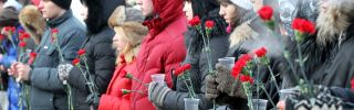 People hold flowers in central Moscow.