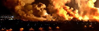 Fires burn on the west bank of the Tigris River in Baghdad, Iraq, on March 21, 2003.