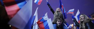 Activisits from the pro-Kremlin youth groups celebrate the victory of the United Russia party.