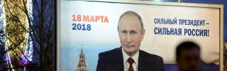 """A billboard with an image of Russian President Vladimir Putin reads """"Strong president - Strong Russia"""" in St. Petersburg on Jan. 12, 2018."""