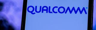 A smartphone displays Qualcomm's company logo.