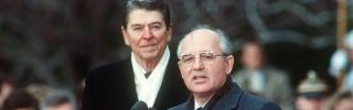 Soviet leader Mikhail Gorbachev speaks in front of U.S. President Ronald Reagan during a welcoming ceremony at the White House on the first day of a disarmament summit on Dec. 8, 1987.