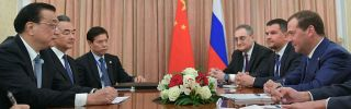 Russian Prime Minister Dmitri Medvedev and Chinese Premier Li Keqiang meet on Oct. 12 during a gathering of the Shanghai Cooperation Organization in Dushanbe, Tajikistan.