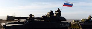 A picture of a Russian self-propelled artillery gun motoring along a Ukrainian highway