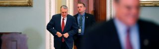 Then-Minority Whip Jon Kyl of Arizona, left, heads for a closed session of the Senate on Dec. 20, 2010, to discuss the strategic arms treaty known as New START.
