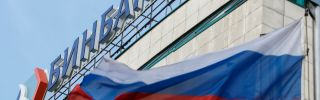 A Russian flag flies next to the headquarters of B&N Bank in downtown Moscow.