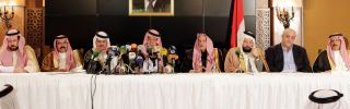 Members of Syria's pro-government tribes sit for a press conference.