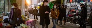 Shoppers wearing face masks amid concerns over the COVID-19 novel coronavirus outbreak in a market in Seoul, South Korea, on March 14, 2020.