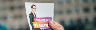 A volunteer hands out leaflets supporting Swedish Democrats leader Jimmie Akesson on Sept. 10, 2014, in Stockholm.