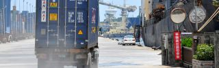 A container truck drives along a pier at Taiwan's busy northern Keelung harbor.