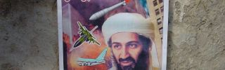 A poster found in an al Qaeda classroom shows Osama Bin Laden smiling and surrounded by military vehicles.