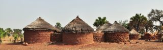 A picture showing round brick huts near Grottes de Nok in Togo.
