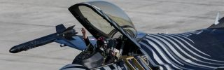 The pilot of a Turkish F-16 greets the crowd after performing at the Teknofest Istanbul Aerospace and Technology Festival in Istanbul on Sept. 22, 2019.