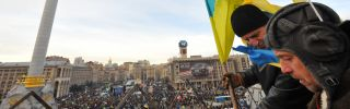 Opposition protesters place flags on surrounding buildings as thousands rallied in Independence Square in Kiev on Dec. 3.