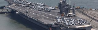 The USS George Washington aircraft carrier ports in Busan, South Korea, in July 2014.