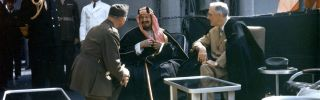 King Abdul Aziz Ibn Saud of Saudi Arabia speaks to US President Franklin D Roosevelt.
