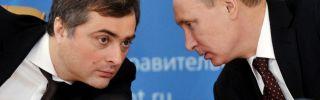 Russia's Prime Minister Vladimir Putin confers with his deputy Vladislav Surkov.