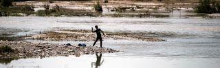 A boy throws a stone into a river near Arbil, the capital of Iraqi Kurdistan.