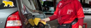 A service station worker fills up a customer's tank at a petrol station in Jakarta.