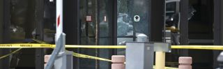 Shattered doors at the Earle Cabell Federal Building in Dallas, Texas, show evidence of a shooting committed by a lone gunman on June 17, 2019. The attacker was killed by police.