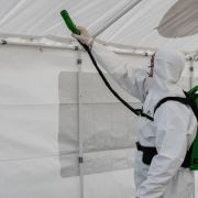 A worker disinfects a field hospital for COVID-19 patients March 20, 2020, in Cremona, Italy.