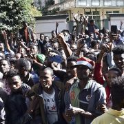 Supporters of Jawar Mohammed, a member of the Oromo ethnic group and high-profile opposition activist, gather outside Ethiopian Prime Minister Abiy Ahmed's home following rumors that his security forces had tried to orchestrate an attack against Mohammed.