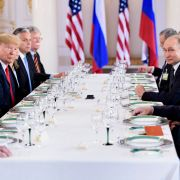 U.S. President Donald Trump (3L), Russian President Vladimir Putin (2R) and others wait for a working lunch meeting at Finland's Presidential Palace on July 16, 2018 in Helsinki. Key topics of their meeting will include sanctions, arms control, and the conflicts in Ukraine and Syria.
