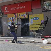 South African law enforcement officers clash with looters during xenophobic violence and looting on Sept. 2, 2019, in Johannesburg.