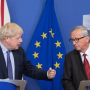 British Prime Minister Boris Johnson (L) and European Commission President Jean-Claude Juncker converse ahead of the European Council summit in Brussels on Oct. 17, 2019.