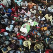 Supporters of Malian presidential candidate Soumaila Cisse hold posters as they attend a campaign rally in Bamako on July 8, 2018.