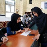 This photo shows a woman voting in Iran's 2016 parliamentary elections.