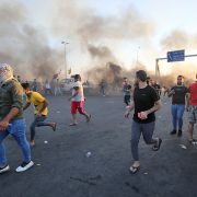 This photo show burning tires in a Baghdad street during protests on Oct. 5.