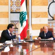 Lebanese President Michel Aoun (R) heads the first meeting of Prime Minister Hassan Diab's (C) newly constituted government in Beirut on Jan. 22, 2020.