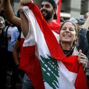 Anti-government protesters in Beirut celebrate Lebanese Prime Minister Saad al-Hariri's resignation on Oct. 29, 2019.