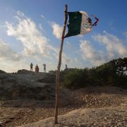 A Mexican flag at a beach Sept. 18, 2019, in Cancun, Mexico.