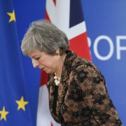British Prime Minister Theresa May leaves after a news conference on Dec. 14 in Brussels, during the second day of a European Union summit.