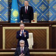 Former Kazakh President Nursultan Nazarbayev, top, and Kazakhstan's interim president Kassym-Jomart Tokayev, bottom, attend a joint session of Parliament on March 20, 2019.